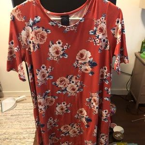 Burnt orange dress with floral pattern and pockets